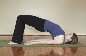 bandha sarvangasana bridge pose 300x196 Yoga Styles and Yoga Poses For Starters [Infographic]