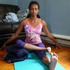 Variation of Lotus Pose - Seated Ankle To Knee Pose